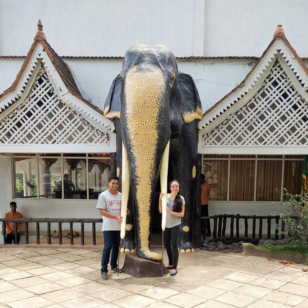 Sri Lanka honeymoon - being token tourists in front of an elephant statue