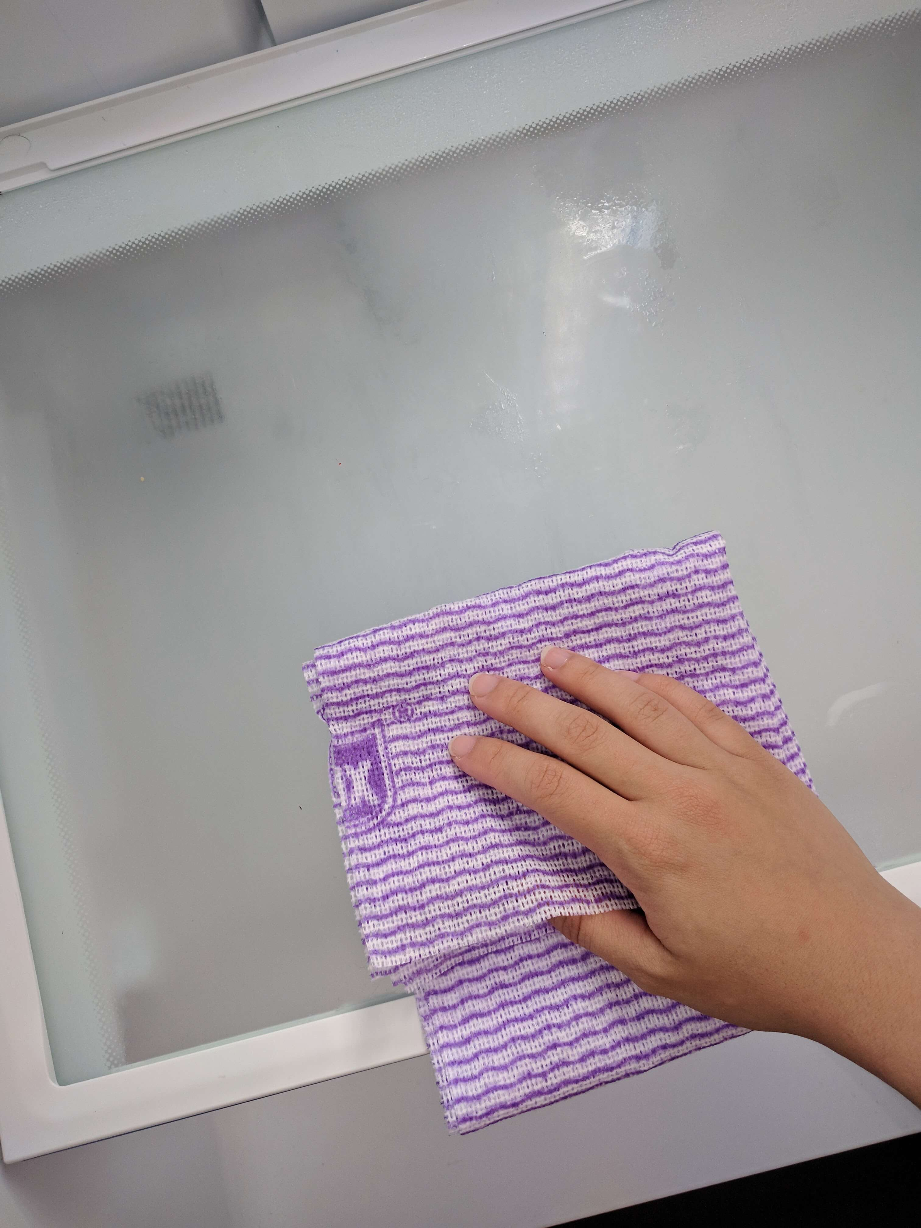 How to clean your fridge - wiping fridge interior 2