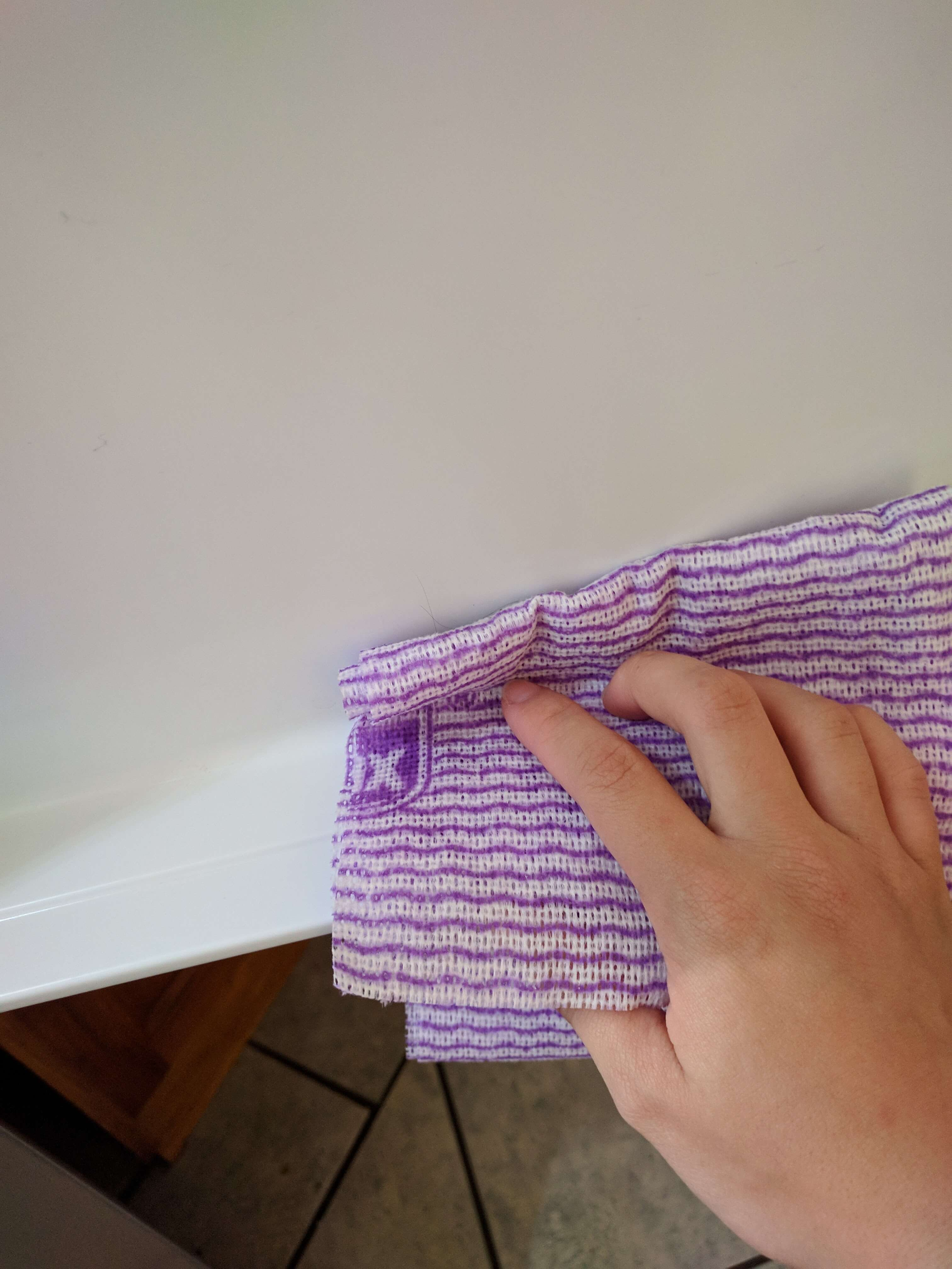 How to clean your fridge - wiping fridge interior 3