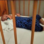 Charles sleeping in cot