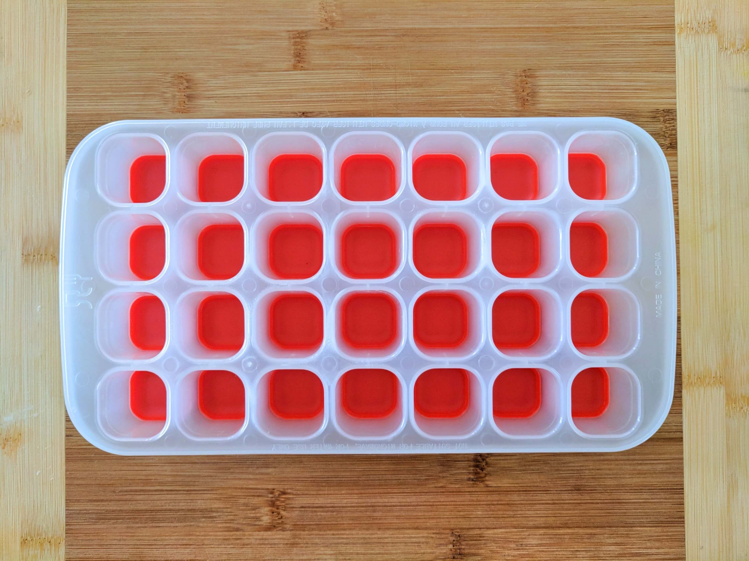 Ice cube tray with silicone base