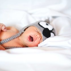 Yawning baby with beanie